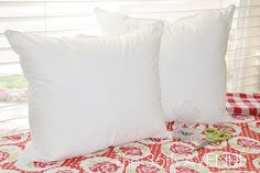 So making a TON of these for the couch.   How to make 2 throw pillow forms from a king size pillow... cheaper than the inserts from the craft store. :)