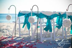 teal sashes, white chairs, white flower balls w/crystal handles