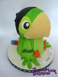 Parrot Birthday Cake Cake decorated in buttercream and parrot made