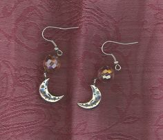 """Aurora Dawn"" Earrings from katsinger http://katsinger.storenvy.com/products/5436157-aurora-dawn-earrings  Aurora, the goddess of the dawn, extends her rosy fingers and opens the gates of heaven*Mother of the Winds, she renews herself every morning and flies across the sky, announcing the arrival of the sun. Time now for you to rise, renewed, open the gates, and announce the arrival of all things bright and beautiful. Time now for the ""Aurora Dawn""."