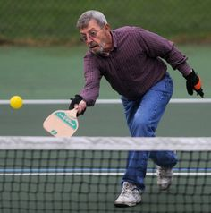 Pickleball is a combination of tennis, Ping-Pong and badminton. It's become especially popular with seniors because it's low-impact. #senioractivities