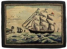 Hooked rug with ship and lighthouse.