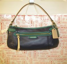 'BNWT, F23978 Coach Daisy Leather Cross Body, Navy/Tan' is going up for auction at  3pm Wed, Nov 13 with a starting bid of $1.