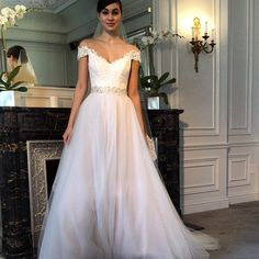This blush gown from Legends by Romona Keveza, with scalloped lace off--the-shoulder straps, is so feminine