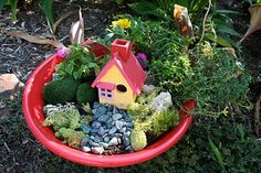 This portable fairy garden is great for those with limited outdoor space.  I love that it could be brought indoors too!