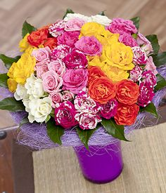 Bunches.co.uk Summer Spray Roses FSSRS A colourful summer selection of 12 Spray Roses in soft pink, hot pink, sunny yellow and vibrant orange shades nestled on a bed of exotic Aralea leaves and delivered in a gorgeous lilac sisal holder. E http://www.comparestoreprices.co.uk/flowers-and-flower-delivery/bunches-co-uk-summer-spray-roses-fssrs.asp