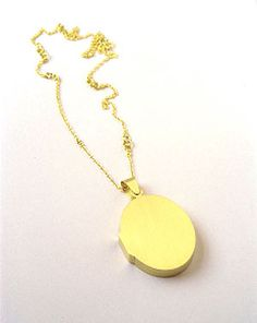 Lin Cheung, Locked Locket Pendant, 2005 - I love these, the idea that the locket has symbolism even without the innards.