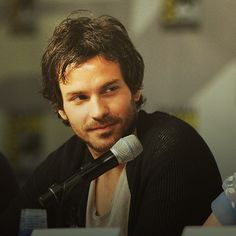 "Santiago Cabrera at a SDCC panel for Merlin- Great, now that I've seen the panel this picture is from, all I can think of is him joking about ""a group of swords"""