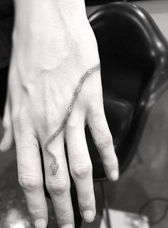 Cara Delevingne's snake tattoo by Doctor Woo