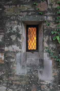 stone wall with leaded window by mcalpine tankersley