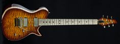 Carvin Guitars SCB6C, deep vintageburst on quilted maple (QDV), natural beveled body binding (BBEB), swamp ash body (ASH), matching quilted maple headstock (QPH), reverse pointed 3+3 headstock (HR33), Floyd Rose locking nut (LN), stainless steel jumbo frets (STJF), black acrylic diamond inlays (DBA), birdseye maple fingerboard (BMF), metal covered neck pickup (S22J), metal covered bridge pickup (S22B), Dunlop straplocks (SL), gold (G), gold logo (GL)