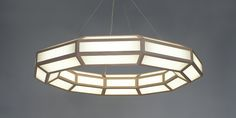 Our first self produced line of lighting creates unique voluminous forms  utilizing flat glass and thin wooden frames. The dimmable LEDs allow the  lights to be dimmed from functional light to lower mood light.  Material - Ash & White Glass  Light - 12V / 100 Watt Illumination AC Dimmable  Suspension - Wire cable  Specifications - Various wood species colored glass and drop lengths  available  Standard size 43 W x 40 D x 6 H  Please inquire within for lead time. Price does not include ...