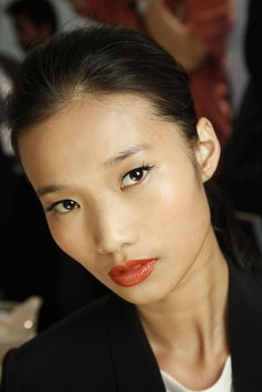 Tangerine lips and a subtle cat eye flick at Dennis Basso Spring 2014