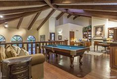 Traditional Game Room with High ceiling, Carpet, Hardwood floors, Exposed beam