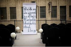 A favorite poem written on a scroll makes for a modern ceremony backdrop.