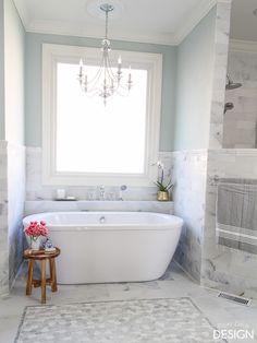 The final reveal of a diy marble master bathroom featuring a blunt herringbone floor, mosaic tile wall, mosaic tile shower floor in a walk-in, doorless, Master Bathroom Tub, Bathroom Windows, Bathroom Flooring, Bathroom Interior, Bathroom Renos, Bathroom Ideas, Shiplap Bathroom, Concrete Bathroom, Bathroom Organization