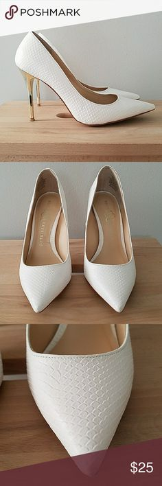 Rock & Republic white snakeskin texture pumps sz 6 Textured pumps with gold heels. I think I've worn these twice, maybe three times, love them but too small for me now :( Heel height 4 inches Rock & Republic Shoes Heels