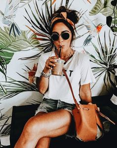 Cut off shorts and white t-shirts are perfect for sipping iced coffee on a cool day. Visit Daily Dress Me at dailydressme.com for more inspiration