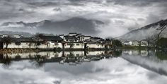 Ancient Village - in the province of Anhui , the ancient village  of Hongcun  stand  there for 900 years  shooting still early morning with over cast  to create this mood of oil Chinese painting