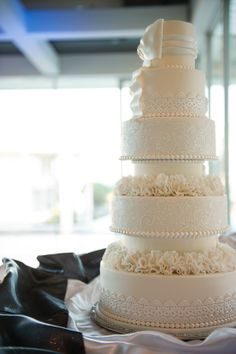 Stunning ivory wedding cake with pearls, lace, ruffles and so much more detail.  Beautiful cake.  ᘡղbᘠ