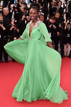 """Cannes : The res-carpet star Lupita Nyong'o wowed in a pleated jade - green Gucci number at the """"Standing Tall premiere on May 13."""