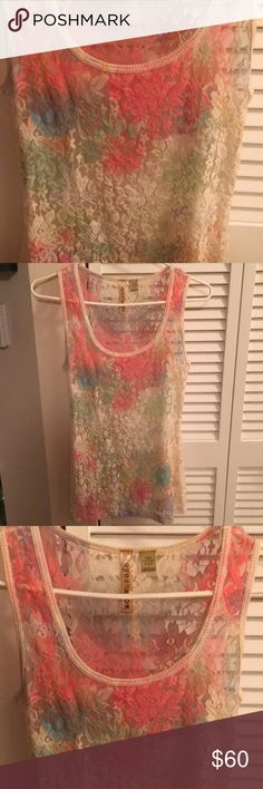 Eyeshadow Sheer Sleeveless Top color galore, New Eyeshadow Sheer Sleeveless Top color galore, New NWOT- ungodly expensive but if you get it you can see why! it looked long enough to fit me but was not... It's truly beautiful. I cannot say enough but you can see the pics. 90 Poly & 10 spandex. Energie Tops