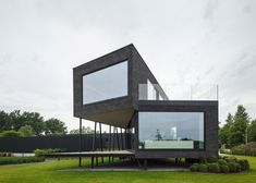 This office is raised on angled stilts to protect it from flooding.