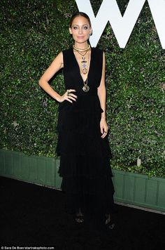 Exquisite: Nicole Richie, 35, carefully matched in her all-black outfit, enhanced by a slew of trendy accessories around her neck and on her fingers