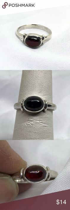 🆕Simple Sterling Silver & Deep Red Stone Ring A simple Sterling ring with a deep red glass stone. Size 6 3/4. In excellent condition. Sometimes, you just want a simple piece of jewelry, and this is it! Jewelry Rings