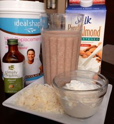 IdealShape Almond Joy Meal Replacement Smoothie - 1 Scoop Chocolate IdealShape Shake Mix - 8 oz. skim milk or Unsweetened Almond Milk - 2 Tlbs Ricotta - 1/8 tsp Almond Extract - 1 Tlbs Coconut Flakes - Ice Cubes    -   #IdealShape