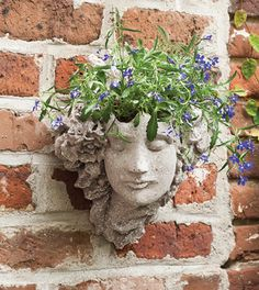 "Grace Wall Planter $125. Transform a dull wall with this wall planter handcrafted of Marmolina, a mixture of crushed stones. The planter is lovely alone or plant with flowers of your choice. Size: 11""W x 5.5""D x 12""H: planting depth 3"""