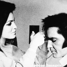 Priscilla cutting Elvis's hair.  Even getting his hair cut, he's absolutely gorgeous!