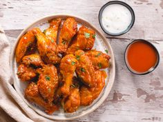 Baked chicken wings tossed in a buttery buffalo sauce served with avocado dipping crema. The key is to chill the wings in the fridge for 2 hours so the skin dries out and the chicken wings get insanely crispy in the oven. Sauce Buffalo, Homemade Buffalo Sauce, Homemade Sauce, Buffalo Chicken, Baked Chicken Recipes, Healthy Chicken, Dog Recipes, Cooking Recipes, Keto Recipes