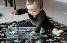 Water Play by funathomewithkids: This sounds simple and definitely low tech,  but there is something special about getting to play with water outside the bath. Use a glass baking tray on a waterproof mat and add some floating toys! #Babies #Sensory_Play #WAter