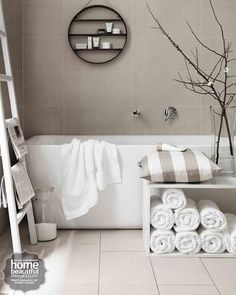 Round shelf / Accessories lift this simple bathing zone; they include rolled towels stacked in a storage cube from Forest For The Trees, a 'Circle' shelf from Bride & Wolfe and a ladder from Shack. Bathroom Renos, Laundry In Bathroom, Bathroom Interior, Modern Bathroom, White Bathroom, Neutral Bathroom, Bathroom Ideas, Design Bathroom, Classic Bathroom