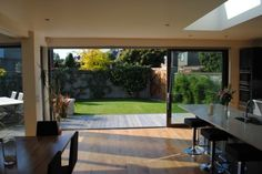 Modern Home Remodel Design with Living Space Extension: Modern House Extension & Remodel Kitchen Fancy Metal Bar Stools Single Storey Extension, Internal Sliding Doors, Casa Patio, 1930s House, Grand Designs, House Extensions, Open Plan Living, My Dream Home, Home Projects