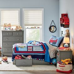 Rough & Tumbler: Code Red Quilted Bedding Set | The large grid pattern on this quilted bedding features stitched appliqués of firemen, trucks, hydrants, and other icons, giving it a bold, graphic look that will excite your own little hero. Made with 100% natural cotton, the top includes a layered border with repeating, geometric design.