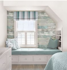 It's got the look of weathered wood with hints of soft pale color, but the walls of this rustic haven are actually made of chic peel and stick wallpaper! WallPops NuWallpaper Beachwood Peel And Stick Wallpaperia via Joann Fabric & Craft Stores.