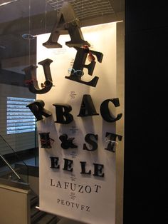 Nothing says get your eyes examined than an Eye Chart. You can customize your message, display new wares and have a little fun with your Eye Chart Decor. Display Design, Store Design, Visual Merchandising, Optometry Office, Store Displays, Window Displays, Eye Chart, Optical Shop, Retail Windows