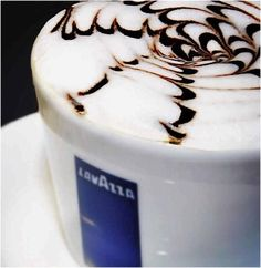 Yummy #coffee latte art served up in a #Lavazza branded cup