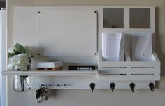 Shabby Chic Nautical Beach Cottage Entryway Mirror Dry Erase Board Vase Flower Key ring Coat Rack Hanger Mail holder Organizer Whisper White. $58.95, via Etsy.