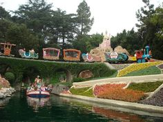The Casey Jr. Circus Train passes over the Storybook Land Canal Boats at Disneyland
