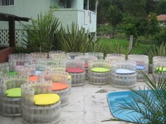 puffs made with plastic bottles are transformed into furniture for pool.