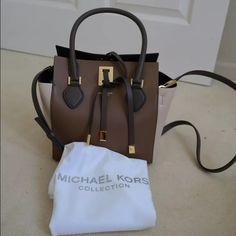MK Miranda XS colorblock messenger tote Brand new condition! Still has some plastic on some of the hardware. Beautiful shades of browns colorblock Michael Kors Bags Crossbody Bags