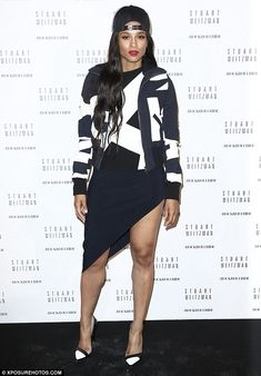 Street chic: Ciara paired a backwards trucker hat with a sexy monochrome asymmetrical dress as she attended the Stuart Weitzman party in Paris on Monday night.