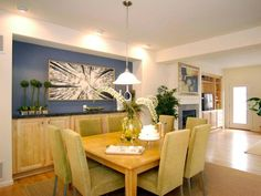 Dining Room Accent Wall: The bold dining room wall acts as the focal point of this mostly neutral space. Eclectic artwork draws even more attention to the dining room