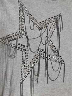 Ribbed collar. Raw cut edges. Star studded front panel. Chains on front panel. Sample size: S