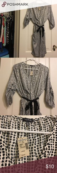 NWT Maurices black & white dress Sz Lrg Beautiful Grogeous! Flattering Maurices black and white dress with belt and pockets. Perfect for casual wear or dressy enough for work or date!!! Retail was $39. Satin material. No flaws or snags anywhere! Maurices Dresses Midi