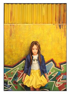 I like the contrast between the graffiti and city like area to the sweet young girl but yet the artist uses the same colours for both and brings them together.  Kevin Peterson Fine Art http://kevinpetersonstudios.com/gallery