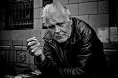 street photography: old man smoking on the street
